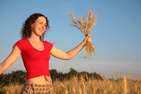 Young woman with earns on wheaten field Stock Photo - 5134769