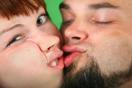 squelch: Close up girl with red hair and guy grimace