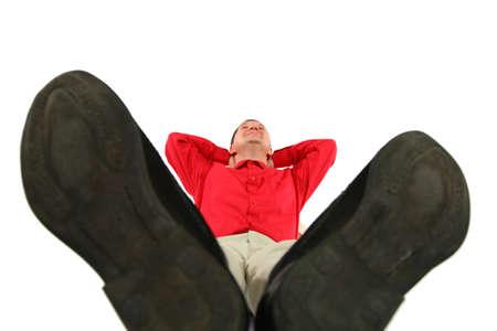 lies forward: Businessman at red shirt lies by feet forward Stock Photo