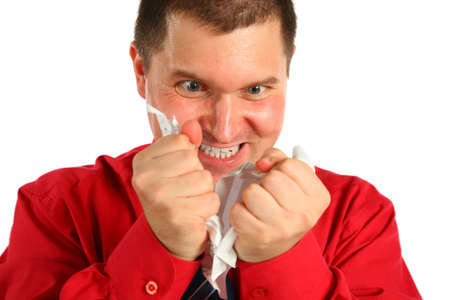 rips: Irate man in red shirt rips sheet of paper