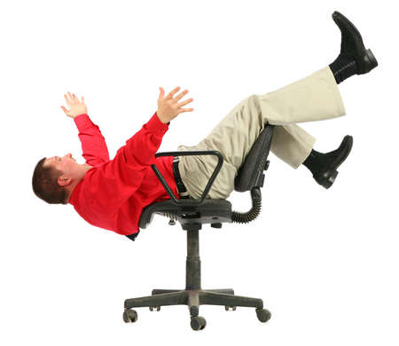 lie forward: Businessman in red shirt falls from chairs upside dow