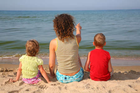 behind mother with children on beach Stock Photo - 5140359