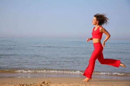 running woman on beach photo