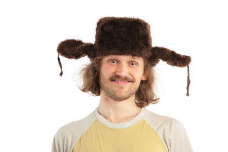 russian man: long-haired smiling Russian man in cap with ear-flaps