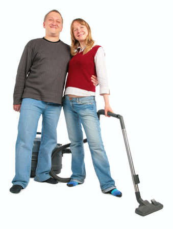 man embraces woman with vacuum cleaner photo
