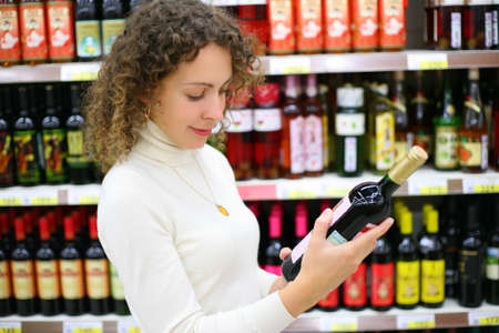 wine trade: Young woman in wine shop