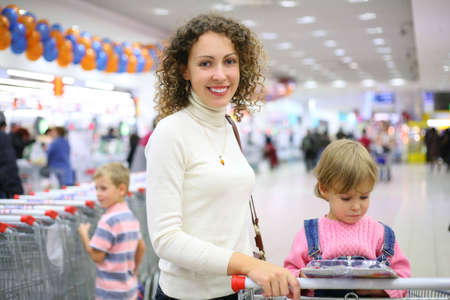 mother with children in shop Stock Photo - 5141379