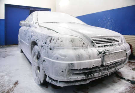 Automobile in soapsuds on washing photo