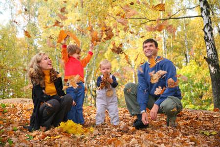 autumn family: family throw autumnal leaves Stock Photo