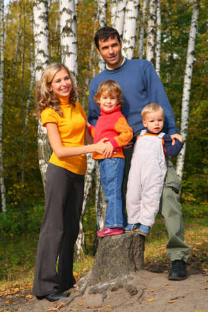 Parents with children in forest in autumn photo