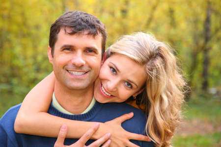 Young woman embraces man from back in autumn wood Stock Photo - 5239449
