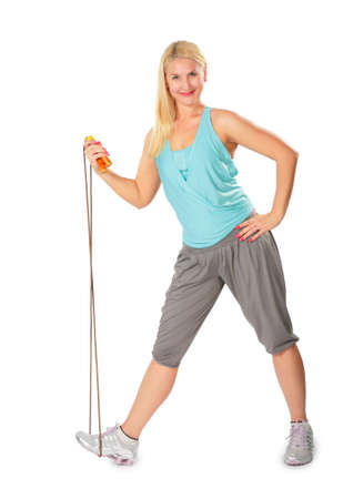 fitness woman with jump rope photo