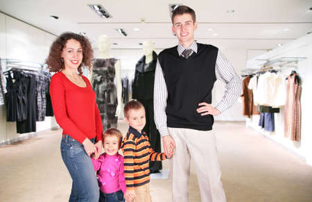 family of four in woman clothes in shop Stock Photo - 5154418