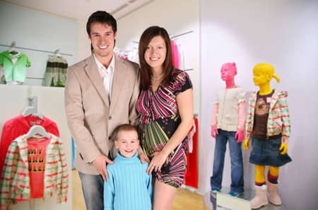 family with boy in Children`s shop photo