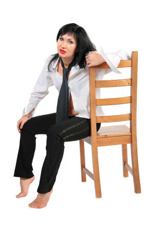 Tired brunette with necktie on chair photo