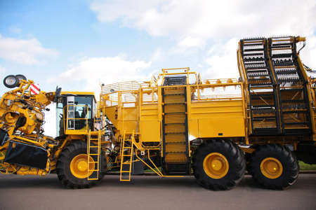 big yellow agricultural truck photo