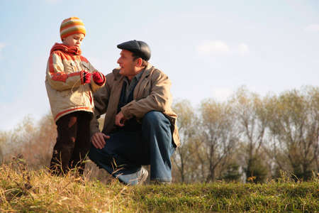 hillock: Grandfather and the grandson sit on a hillock
