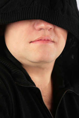 hoodlum: Mysterious person. Close- up.