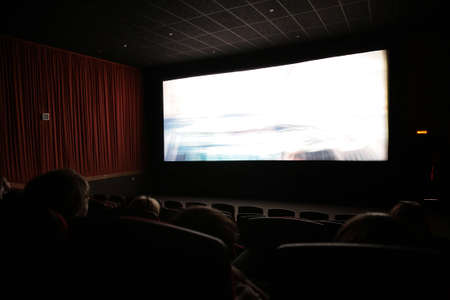 Viewers in cinema, focus on first chairs line photo