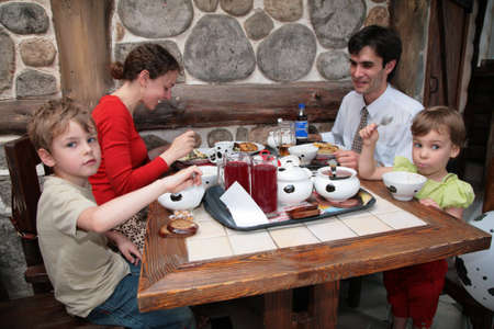 family and health: Family of four sit in cafe