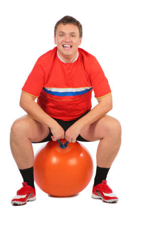 Man sitting on a fitness sphere. photo