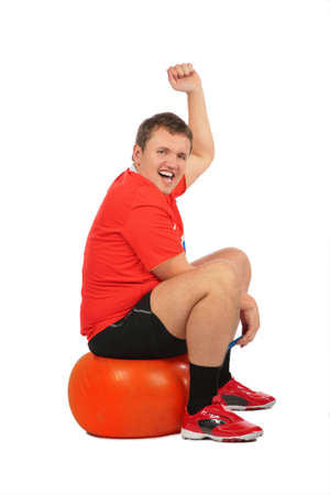 Man jumping on fitness sphere photo