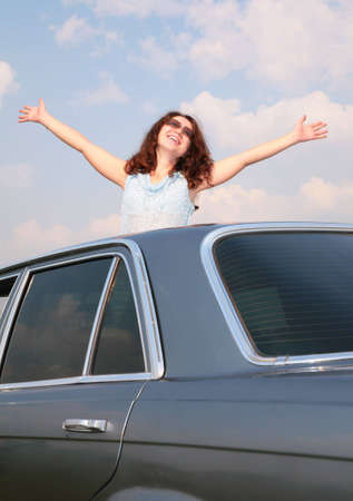 Girl with raised hands and car Stock Photo - 5353461