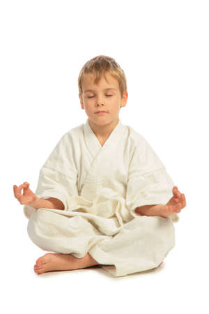 Karate boy meditates photo