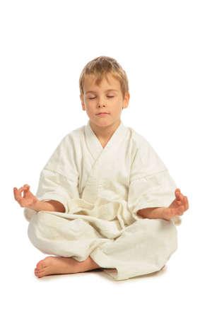 meditates: Karate boy meditates