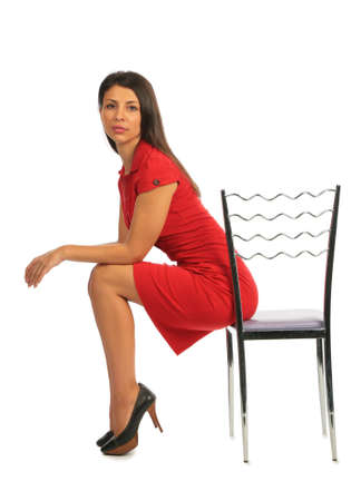 sexy business woman: Woman sitting on a chair, profile Stock Photo