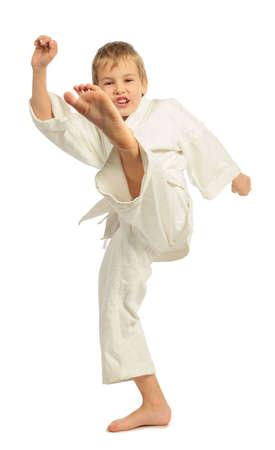 art activity: Karate boy kicking by a left leg Stock Photo