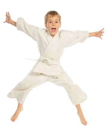 Karate boy jumping photo