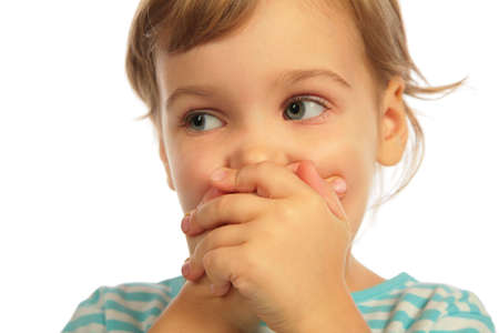 Llittle girl closed a mouth by hands Stock Photo - 5354136