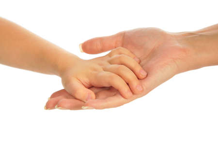 Child`s hand on mother`s hand photo