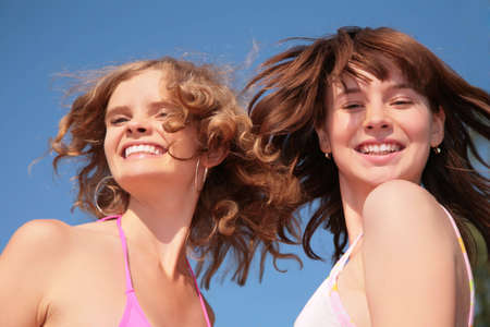 helpmate: Two girlfriend with windy hairs Stock Photo