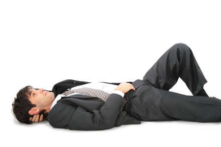 lying forward: Lying on back businessman Stock Photo
