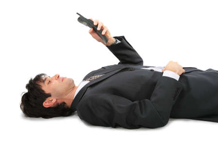 lie forward: Lying on back businessman with phone Stock Photo