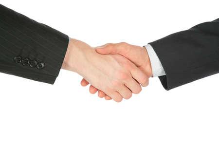 Two handshaking hands Stock Photo - 5342154