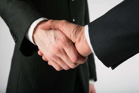 Two men handshake Stock Photo - 5360215