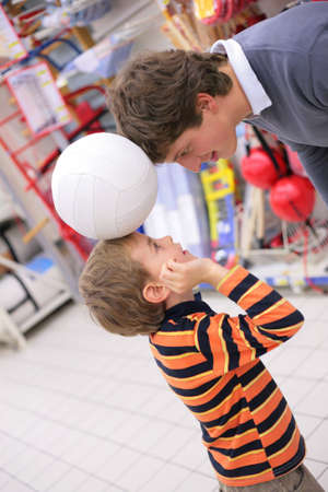 Father with son and ball in shop Stock Photo - 5357379