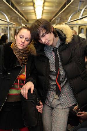 Sleeping pair in subway wagon photo