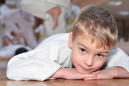 aikido: Lying boy in sports hall Stock Photo