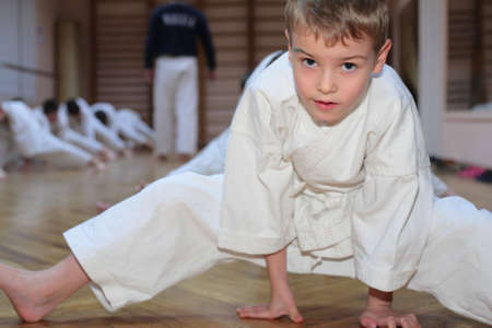art activity: karate boy in sport hall Stock Photo