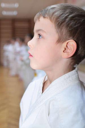 Karate boy in sport hall photo