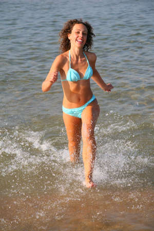 Young woman runs on water photo