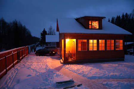 cottage fence: Country house in winter evening
