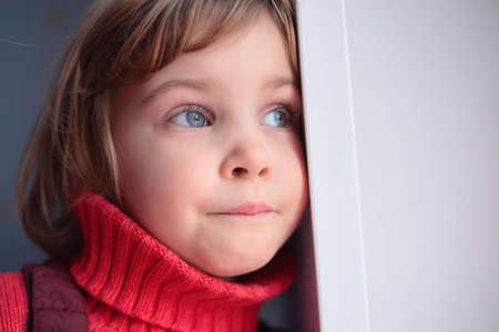 wistful: little thoughtful girl