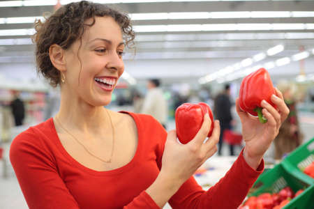 young woman in shop with red sweet peppers Stock Photo - 5352396