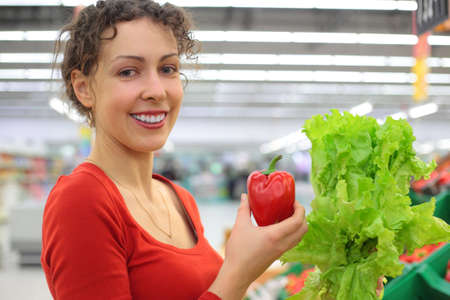 young woman in shop with red sweet pepper and salad Stock Photo - 5368568