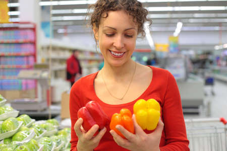 young woman in shop with sweet peppers Stock Photo - 5368559
